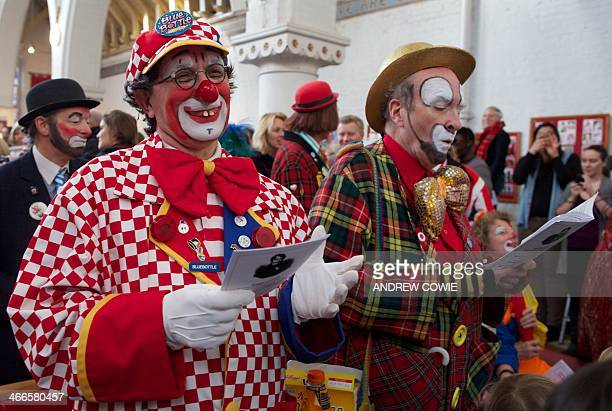 Clowns dressed in full costume attend a Service in memory of celebrated clown Joseph Grimaldi at a church in Dalston East London on February 2 2014...
