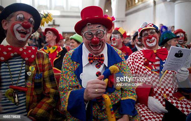 Clowns dressed in full costume laugh as they attend a Service in memory of celebrated clown Joseph Grimaldi at a church in Dalston East London on...