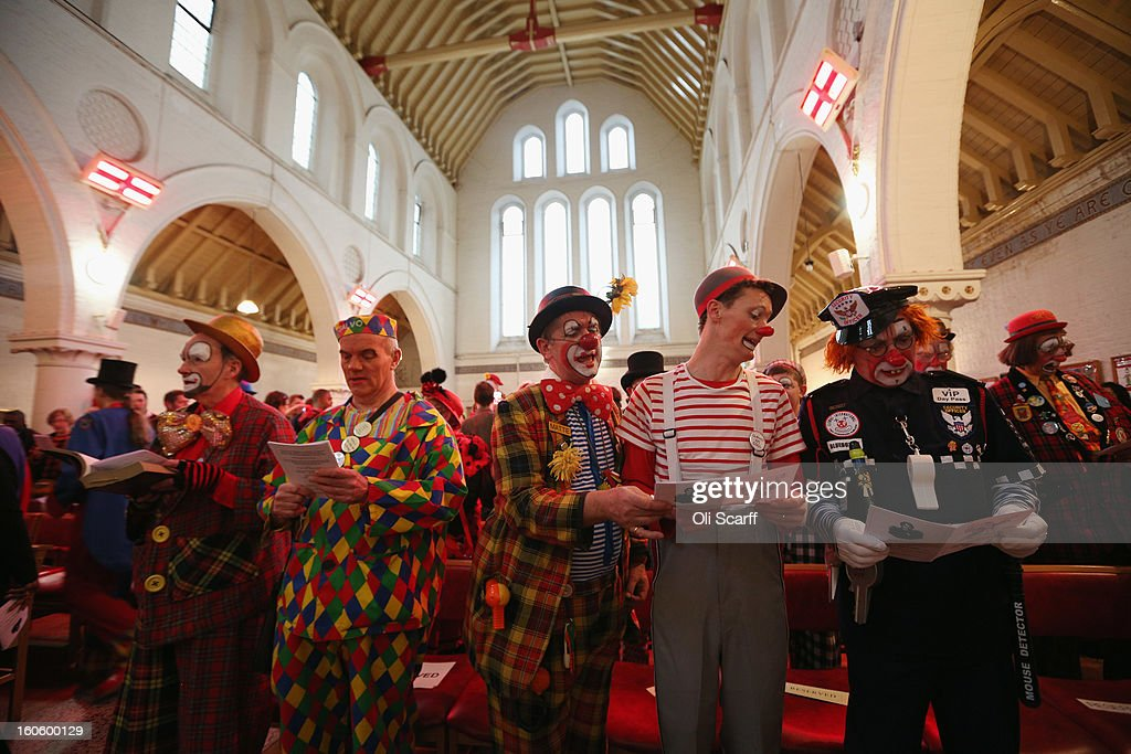 Clowns in full costume sing during the annual Clowns Church Service at Holy Trinity Church in Dalston on February 3, 2013 in London, England. Clowns attend the service in memory of Joseph Grimaldi (1778-1837), the most celebrated English clown who was born in London. The service has been an annual tradition since 1946 with the attending clowns usually performing for the public afterwards.