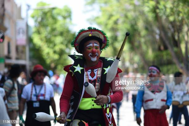 Clowns take part in the celebrations of the fifth edition of the National Clown Day in downtown Guatemala City on April 10 2019