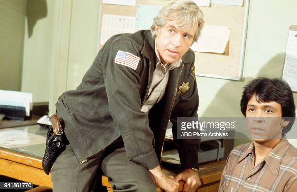 Clu Gulager and Rudy Ramos appearing in the episode 'Highway to Murder' from the television show 'Get Christie Love!'.