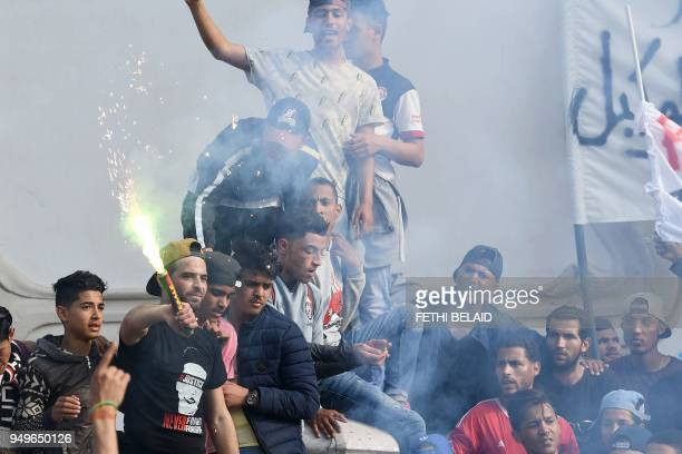 Club Africain fans demonstrate against the police they accuse of causing the death of a supporter in Tunis on April 21 2018 The family of Omar Abidi...