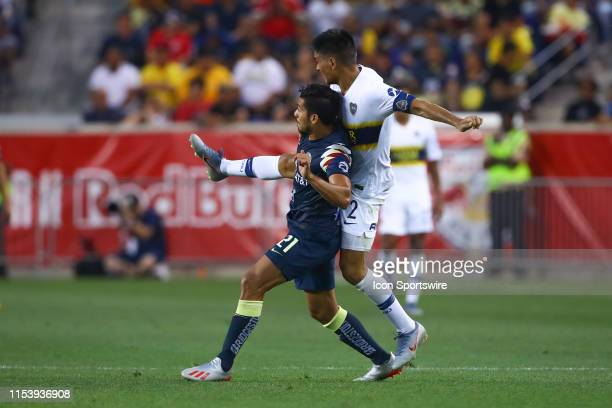 Club America forward Henry Martin battles Boca Juniors defender Paolo Goltz during the Colossus Cup soccer match between Club America and Boca...