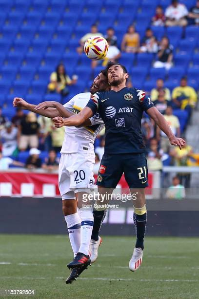Club America forward Henry Martin heads the ball against Boca Juniors defender Lisandro Lopez during the first half of the Colossus Cup soccer match...