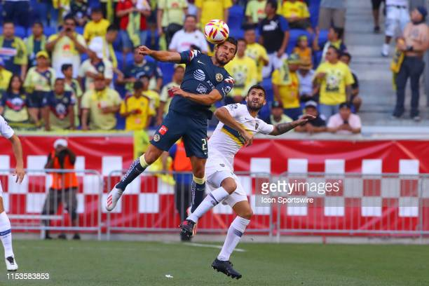 Club America forward Henry Martin heads the ball during the first half of the Colossus Cup soccer match between Club America and Boca Juniors on July...