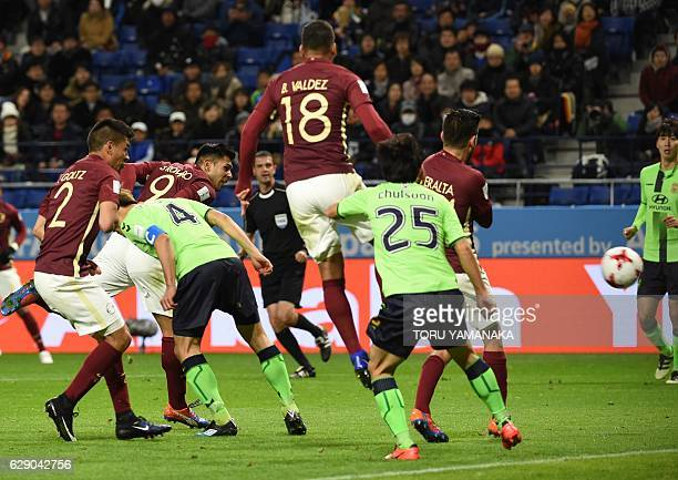Club America forward Silvio Romero heads the ball to score a goal during the Club World Cup football match between Jeonbuk Hyundai and Club America...