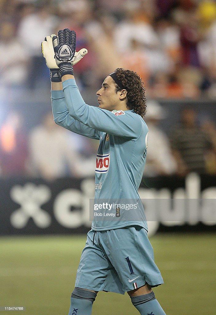 d353148de Club America goalkeeper Guillermo Ochoa gets the crowd going during ...