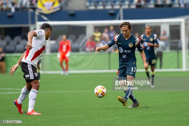 Club America midfielder Sebastian Cordova tries to chip a pass over a River Plate player in the second half during a soccer match between Club...