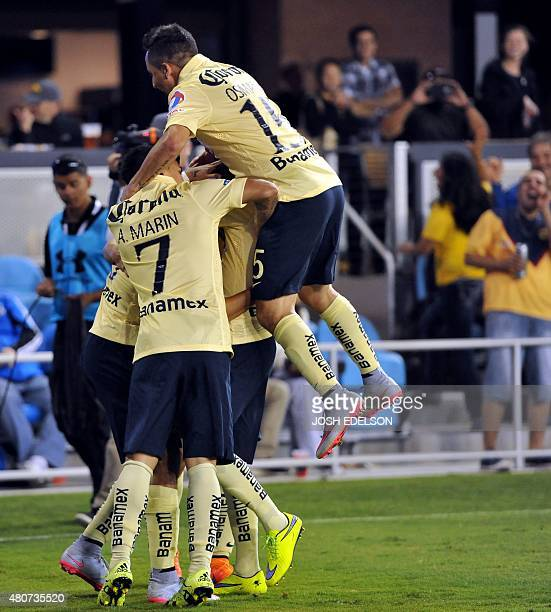 Club America players celebrate after scoring a goal against the San Jose Earthquakes during their International Champions Cup football match at Avaya...