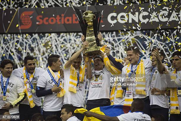 Club America players celebrate with the trophy after defeating the Montreal Impact in the CONCACAF Champions League return leg final 42 to win 53 on...