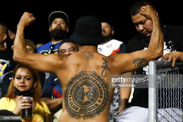 Club America supporter displays their tattoos during the semifinal second leg match of the CONCACAF Champions League 2021 between Philadelphia Union...