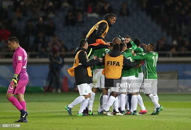Club America's goalkeeper Hugo Gonzalez walks as Atletico Nacional players celebrate after defeating Club America in penalties during the Club World...
