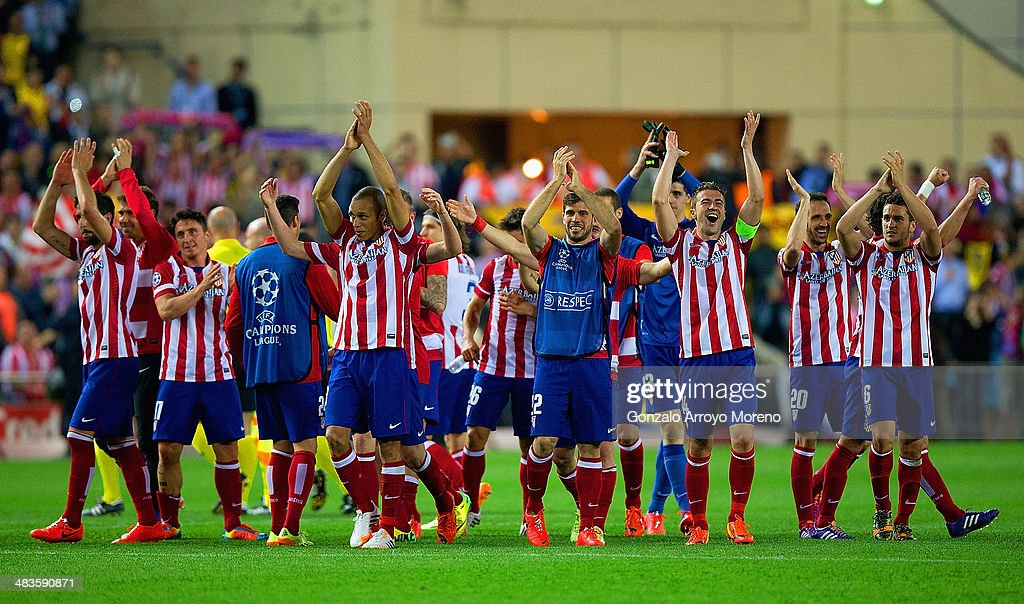 Club Atletico de Madrid applaud their fans as they celebrate victory during the UEFA Champions League Quarter Final second leg match between Club Atletico de Madrid and FC Barcelona at Vicente Calderon Stadium on April 9, 2014 in Madrid, Spain.