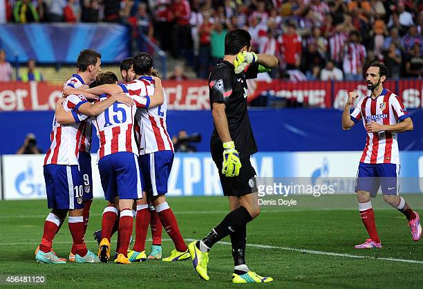 Club Atletico de Madrid celebrate after scoring their opening goal during the UEFA Champions League Group A match between Club Atletico de Madrid and...