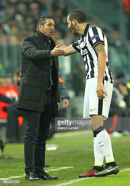 Club Atletico de Madrid coach Diego Simeone speaks to Leonardo Bonucci of Juventus FC during the UEFA Champions League group A match between Juventus...