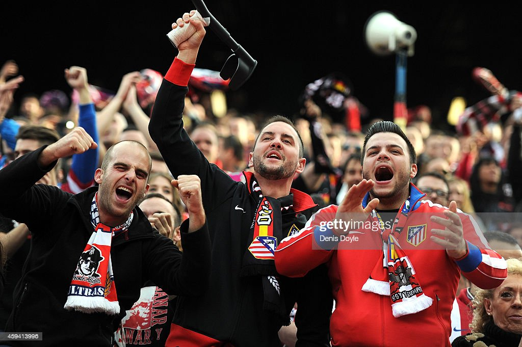 Club Atletico de Madrid fans celebrate after their team scored their 2nd goal during the La Liga match between Club Atletico de Madrid and Malaga CF at Vicente Calderon Stadium on November 22, 2014 in Madrid, Spain.