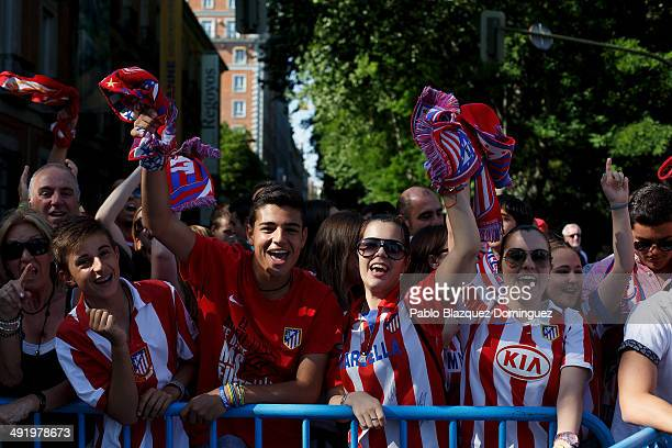 Club Atletico de Madrid fans celebrate as they wait for the players after their tenth La Liga title at Neptuno Square on May 18 2014 in Madrid Spain