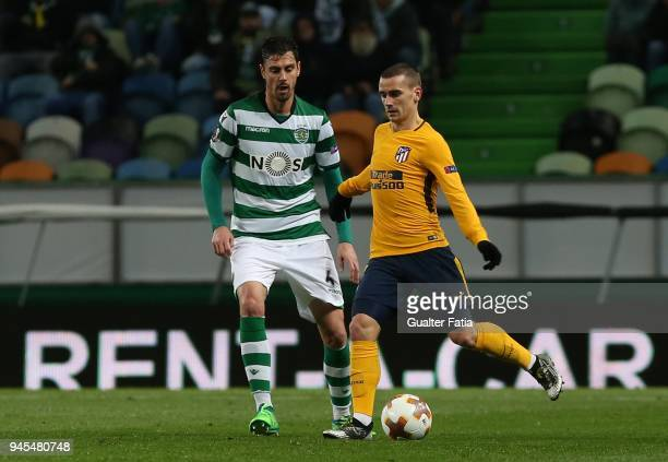Club Atletico de Madrid forward Antoine Griezmann from France with Sporting CP defender Andre Pinto from Portugal in action during the UEFA Europa...