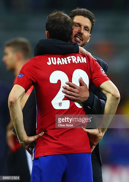 Club Atletico de Madrid head coach Diego Simeone hugs a desperate Juanfran after the UEFA Champions League Final match between Real Madrid and Club...