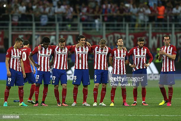 Club Atletico de Madrid look dejected during the penalty shootout following the UEFA Champions League Final between Real Madrid and Club Atletico de...