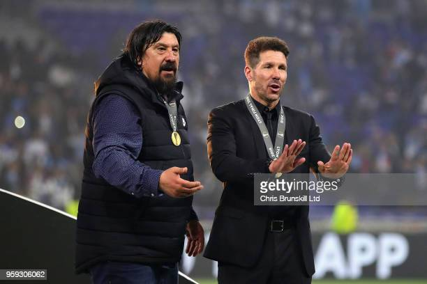 Club Atletico de Madrid manager Diego Simeone and Club Atletico de Madrid assistant manager German Burgos gesture after the UEFA Europa League Final...