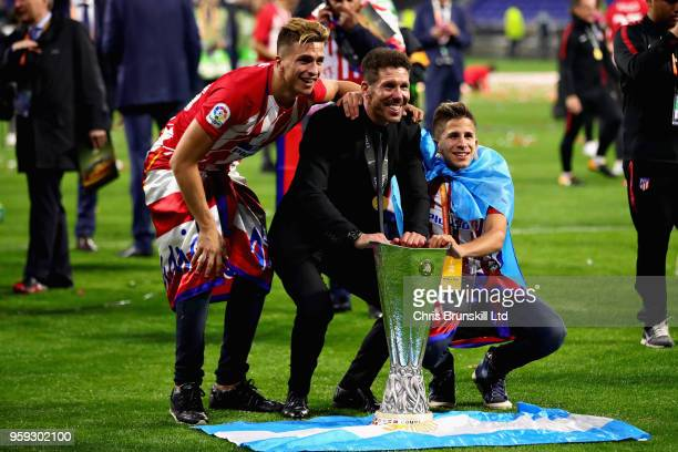 Club Atletico de Madrid manager Diego Simeone celebrates with the trophy after his side won the UEFA Europa League Final between Olympique de...