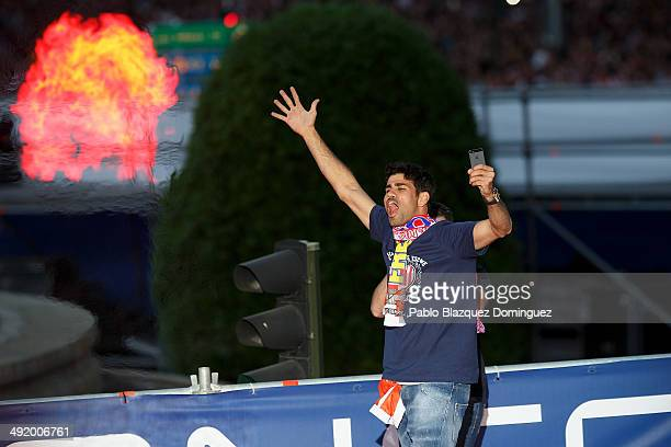 Club Atletico de Madrid player Diego Costa celebrates after their tenth La Liga title at Neptuno Square on May 18 2014 in Madrid Spain