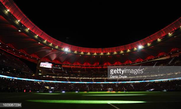 Club Atletico de Madrid players celebrate their UEFA Super Cup victory over archrivals Real Madrid at the end of their La Liga match between Club...
