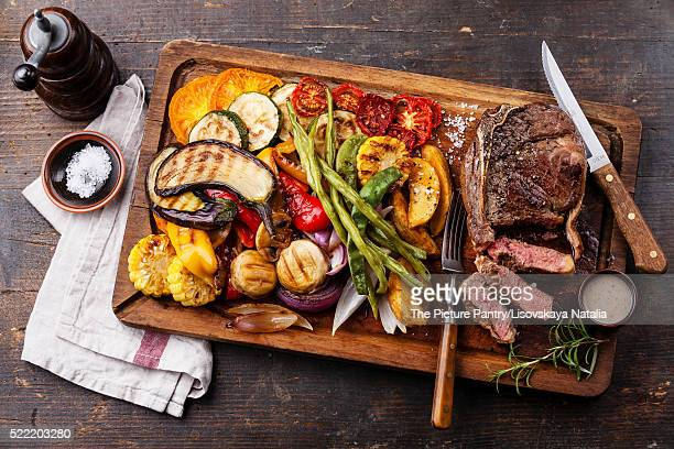 Club Beef steak with pepper sauce and Grilled vegetables on cutt