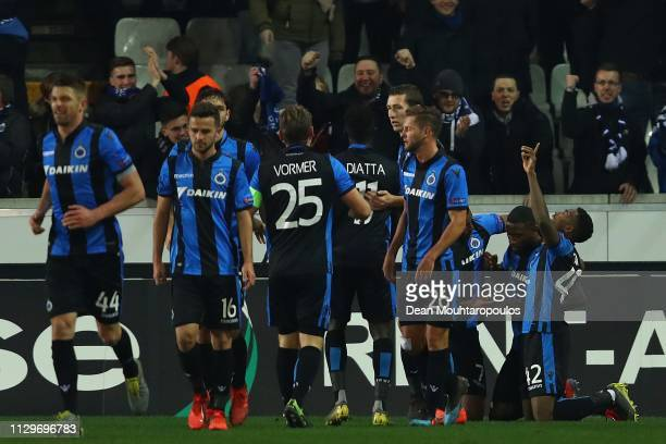 Club Brugge players celebrate after Stefano Denswil of Club Brugge scored his team's first goal during the UEFA Europa League Round of 32 First Leg...