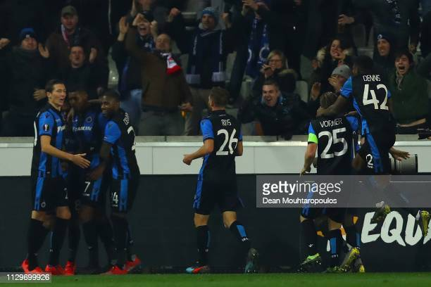 Club Brugge players celebrate after Wesley of Club Brugge scored his team's second goal during the UEFA Europa League Round of 32 First Leg match...