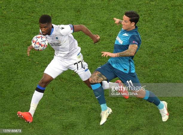 Club Brugge's Angolan defender Clinton Mata fights for the ball with Zenit St Petersburg's Argentine forward Sebastian Driussi during the UEFA...