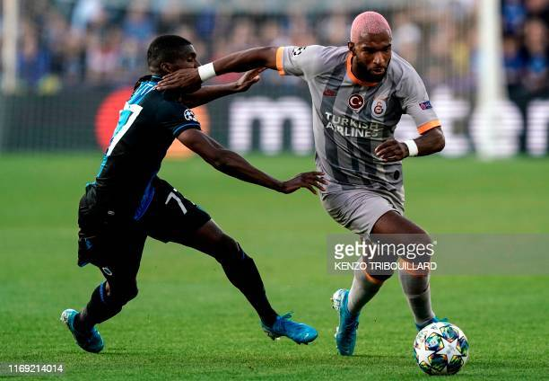 Club Brugge's Angolan defender Clinton Mata vies with Galatasaray's Dutch forward Ryan Babel during the UEFA Champions League Group A football match...