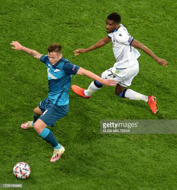 Club Brugge's Angolan defender Clinton Mata vies with Zenit St Petersburg's Russian defender Danil Krugovoy during the UEFA Champions League Group F...