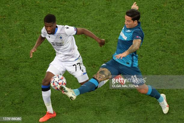 Club Brugge's Angolan defender Clinton Mata vies with Zenit St Petersburg's Argentine forward Sebastian Driussi during the UEFA Champions League...