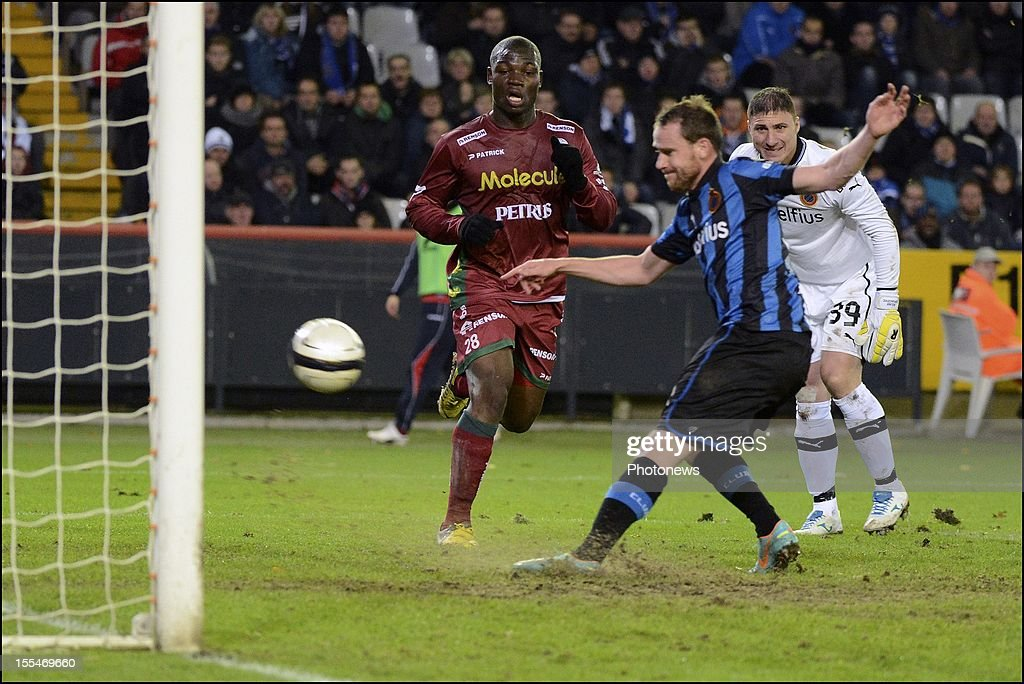 Club Brugge's Bart Buysse and goalkeeper Bogan Jorgacevic challenge Zulte Waregem's Bernard Malanda-Adje during the Jupiler Pro League match between Club Brugge and Zulte Waregem on November 4, in Brugge, Belgium.