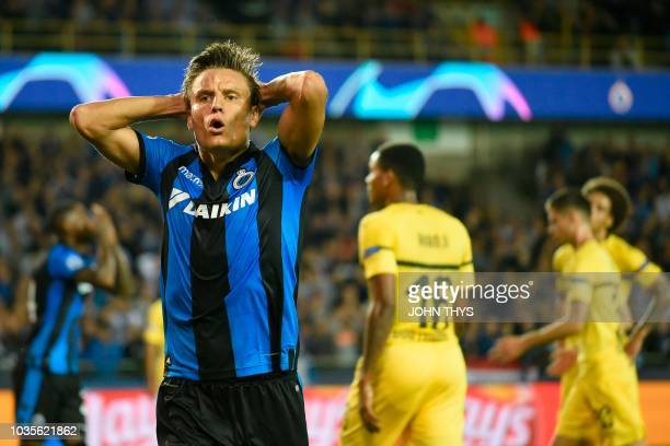 Club Brugge's Belgian forward Jelle Vossen reacts after missing a goal opportunity during the UEFA Champions League Group C football match Club...
