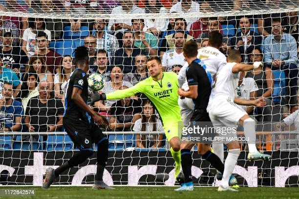 Club Brugge's Belgian goalkeeper Simon Mignolet stops the ball during the UEFA Champions league Group A football match between Real Madrid and Club...