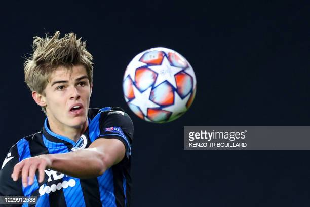 Club Brugge's Belgian midfielder Charles De Ketelaere eyes the ball during the UEFA Champions League Group F football match between Club Brugge and...