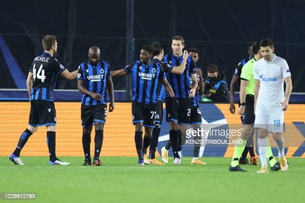 Club Brugge's Belgian midfielder Hans Vanaken celebrates with teammates after scoring the team's second goal during the UEFA Champions League Group F...