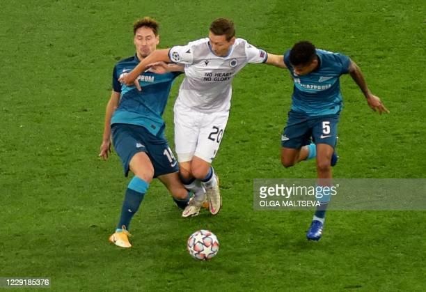Club Brugge's Belgian midfielder Hans Vanaken vies with Zenit St. Petersburg's Russian midfielder Daler Kuzyaev and Zenit St. Petersburg's Colombian...
