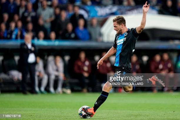 Club Brugge's Belgian midfielder Mats Rits shoots the ball during the UEFA Champions League Group A football match between Brugge and Galatasaray on...
