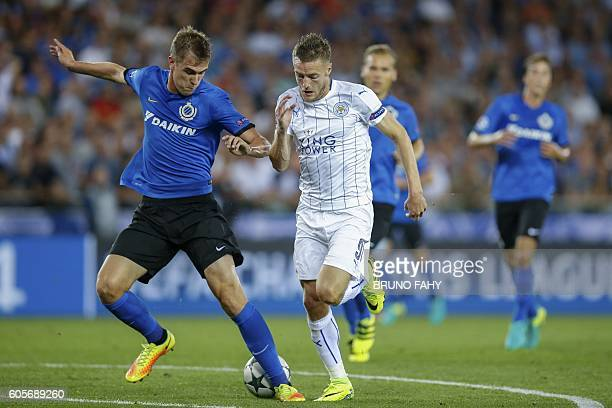 Club Brugge's Bjorn Engels vies with Leicester's Jamie Vardy during the UEFA Champions League football match between Club Brugge and Leicester City...