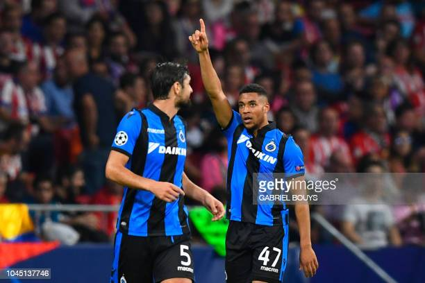 Club Brugge's Dutch forward Arnaut Danjuma celebrates with Club Brugge's French defender Benoit Poulain after scoring during the UEFA Champions...