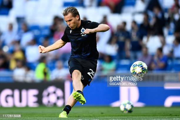Club Brugge's Dutch midfielder Ruud Vormer warms up before the UEFA Champions league Group A football match between Real Madrid and Club Brugge at...