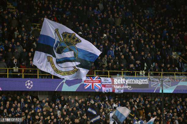 Club Brugges fans wave flags during the UEFA Champions League group A match between Club Brugge KV and Real Madrid at Jan Breydel Stadium on December...