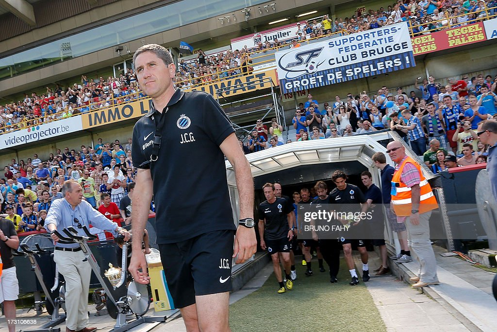 Club Brugge's head coach Juan Carlos Garrido walks onto the pitch during the fan day of the Belgian first league football team on July 7, 2013, in Brugge. Belgium Out