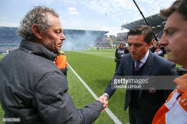 Club Brugge's head coach Michel Preud'homme and Anderlecht's head coach Besnik Hasi shake hands prior to the Jupiler Pro League match between Club...