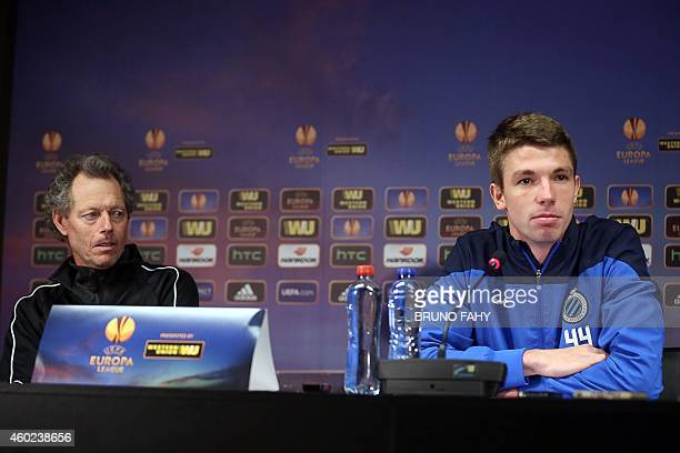 Club Brugge's head coach Michel Preud'homme and defender Brandon Mechele give a press conference on December 10, 2014 in Bruges, on the eve of their...