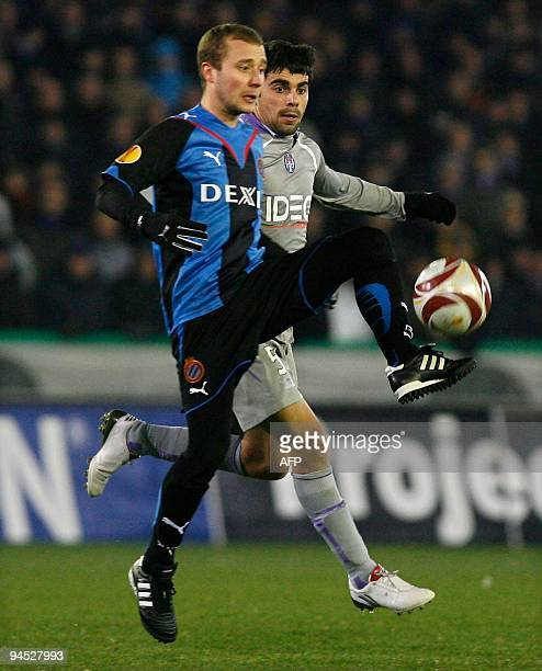 Club Brugge's Jonathan Blondel and Toulouse's Paulo Machado fight for the ball during the UEFA Europa League group J football match Brugge vs...